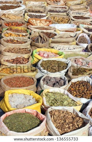 many bags with spices on indian market - stock photo