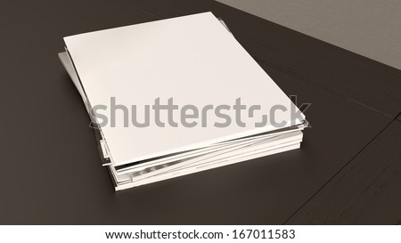 many blank magazines in a stack on the top of the table - stock photo