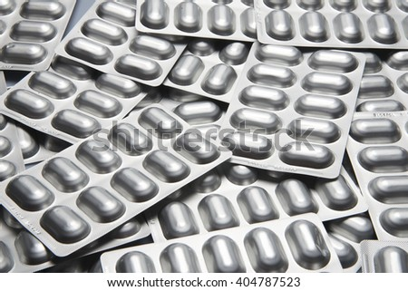 Many blisters filled, silver color, medicine - stock photo