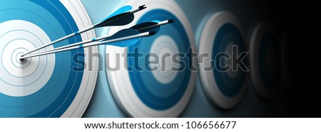 many blue targets and three arrows hitting the center of the first one, horizontal image, banner style - stock photo