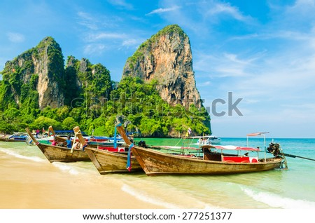 Many Boats On Beautiful Tropical Sand Beach, Krabi, Thailand - stock photo