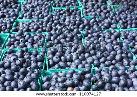 Many boxes of blueberries with soft background at the Farmers Market - stock photo