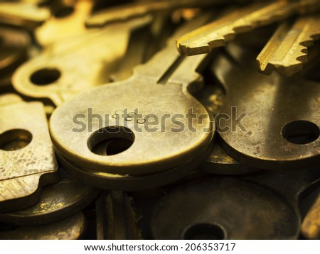 Many brass keys. Many brass keys extremely close up. Security and encryption, concept image. High magnification macro.  - stock photo
