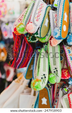 many bright slippers for souvenir in a shop - stock photo