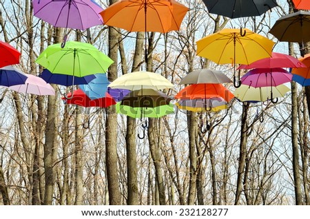 Many Bright umbrellas. Bright Colors. Freedom concept - stock photo