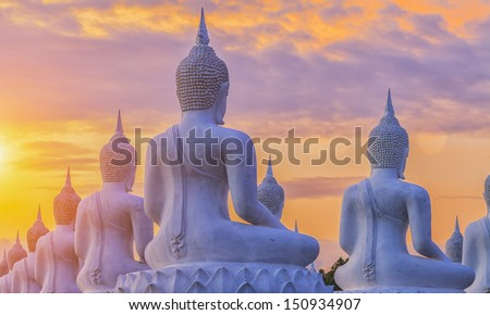 Many Buddha statue on sunset - stock photo