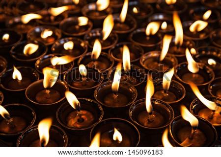 Many candles inside the Swayambhunath temple, Kathmandu - stock photo