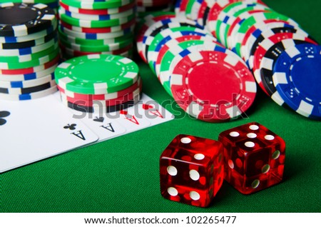 Many cards and casino chips - stock photo