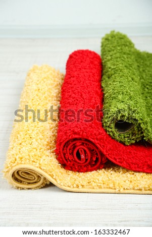 Many carpets of different colors close-up - stock photo