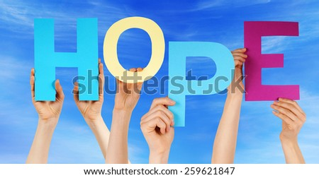 Many Caucasian People And Hands Holding Colorful  Letters Or Characters Building The English Word Hope On Blue Sky - stock photo
