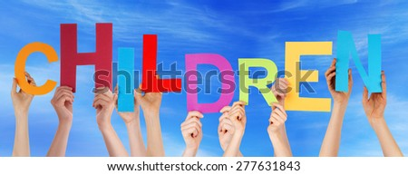 Many Caucasian People And Hands Holding Colorful Letters Or Characters Building The English Word Children On Blue Sky - stock photo