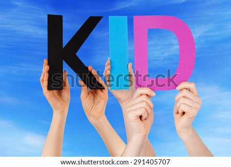 Many Caucasian People And Hands Holding Colorful Straight Letters Or Characters Building The English Word Kid On Blue Sky - stock photo