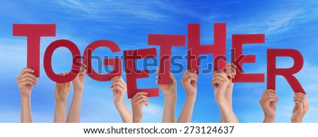 Many Caucasian People And Hands Holding Red Letters Or Characters Building The English Word Together On Blue Sky - stock photo
