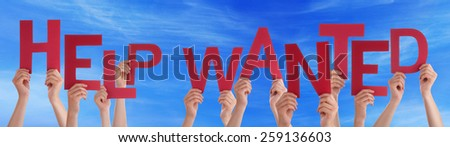 Many Caucasian People And Hands Holding Red Letters Or Characters Building The English Word Help Wanted On Blue Sky - stock photo