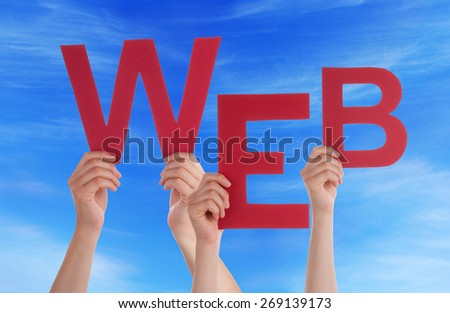 Many Caucasian People And Hands Holding Red Letters Or Characters Building The English Word Web On Blue Sky - stock photo
