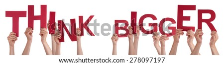 Many Caucasian People And Hands Holding Red Letters Or Characters Building The Isolated English Word Think Bigger On White Background - stock photo