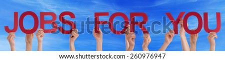Many Caucasian People And Hands Holding Red Straight Letters Or Characters Building The English Word Jobs For You On Blue Sky - stock photo