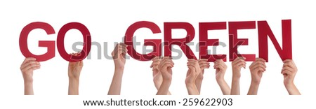Many Caucasian People And Hands Holding Red Straight Letters Or Characters Building The Isolated English Word Go Green On White Background - stock photo