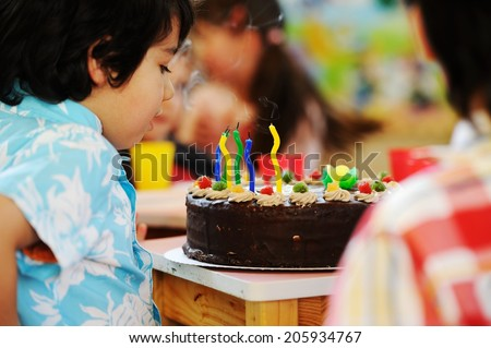 Many children having fun at birthday party - stock photo