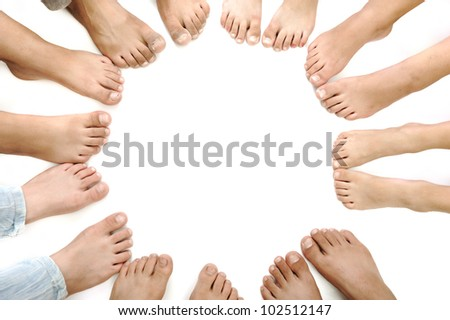 Many children legs on white - stock photo