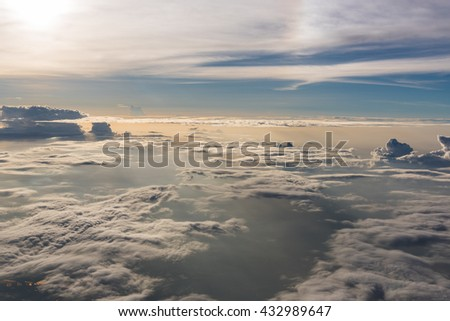 Many cloud in Flying above sunrise, view from outside airplane - stock photo
