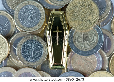 many coins and tomb in still life - stock photo