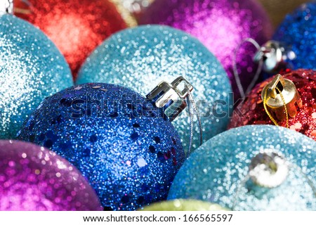 many colored Christmas balls on the background - stock photo