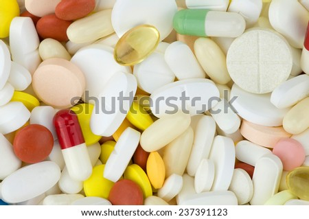 many colored drugs pills shapes texture background - stock photo