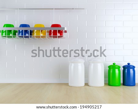 Many-colored kitchenware on the wooden worktop. Kitchen design. - stock photo