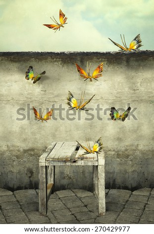 Many colorful butterflies flying into the sky with a peeling wall and a bench, illustrative photo and artistic - stock photo