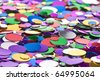 Many colorful confetti close up - stock photo