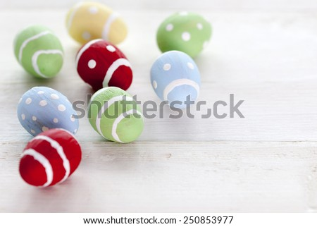 Many Colorful Easter Eggs Which Are Dotted And Striped On Wooden Vintage Background With Copy Space Free Text Or Your Text Here For Happy Easter Greetings - stock photo
