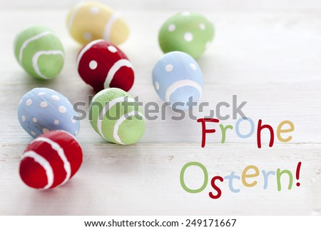 Many Colorful Easter Eggs Which Are Dotted And Striped On Wooden Vintage Background With German Text Frohe Ostern Which Means Happy Easter For Easter Greetings - stock photo