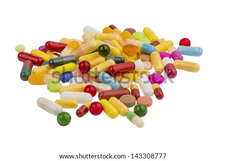 many colorful pills on a white background. symbolic photo for medicine and drugs - stock photo