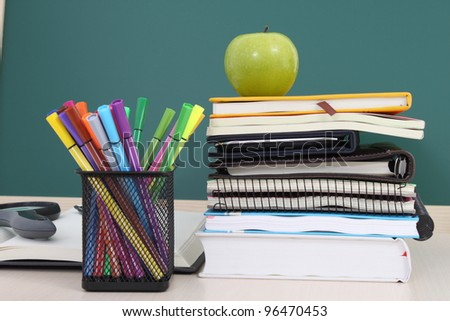 Many Colorful stationery of an assortment on a table. - stock photo