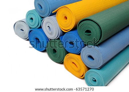 many colorfull yoga mats as a background. isolated on white background - stock photo
