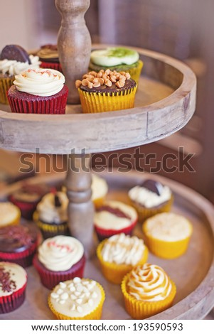 Many cupcakes (soft focus on the top yellow cake) - stock photo