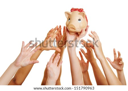 Many desperate hands reaching for money in a piggy bank - stock photo