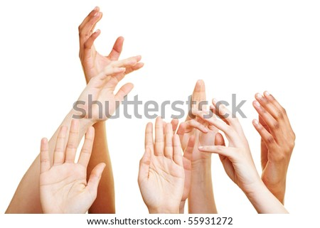 Many desperate hands reaching into the air - stock photo