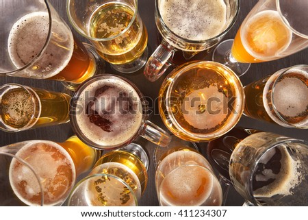 Many different beer glasses with beer from all over the world - stock photo