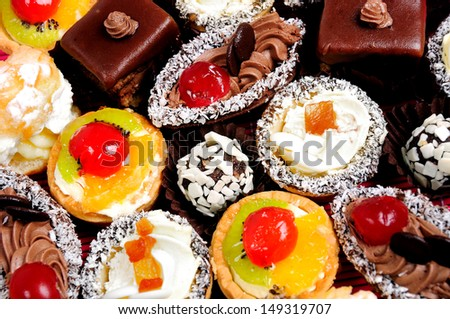 Many different cakes on table  - stock photo