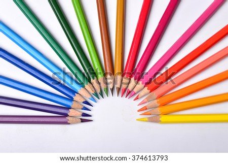 Many different colored pencils on white background - stock photo