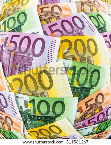 many different euro bills. symbolic photo for wealth and investment - stock photo