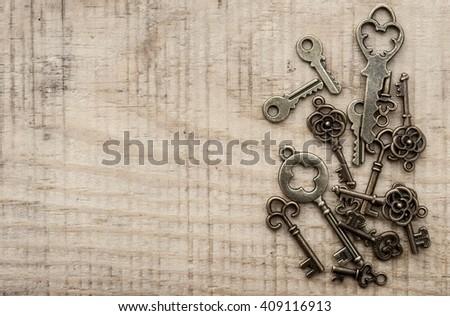 many different keys on vintage background - stock photo