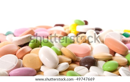 many different pills isolated on white background - stock photo