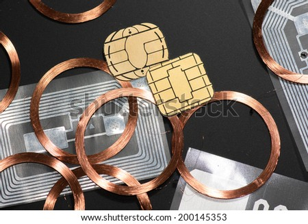 many different RFID Antenna copper coil etched antenna UHF contact chips processor - stock photo