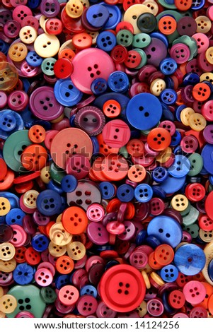 Many different sized and shaped buttons - stock photo
