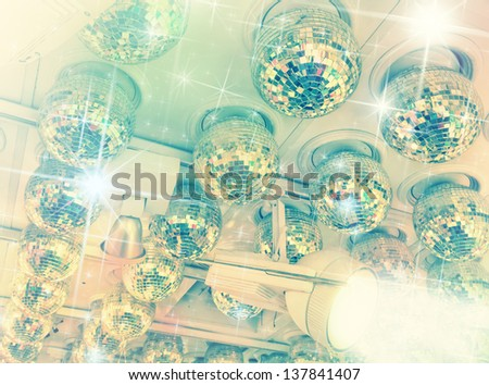 Many disco balls on ceiling in a nightclub - stock photo