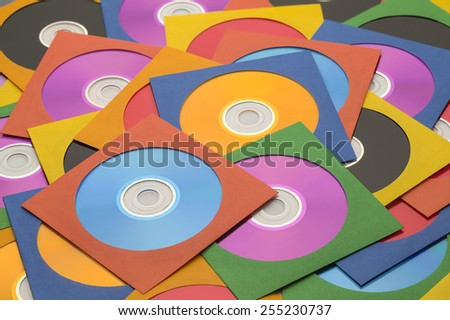 Many Discs in Cases in a large Messy Pile. - stock photo
