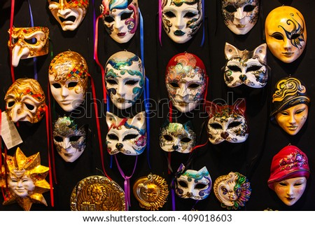 Many distinctive Venetian carnival masks of various colors, black background - stock photo